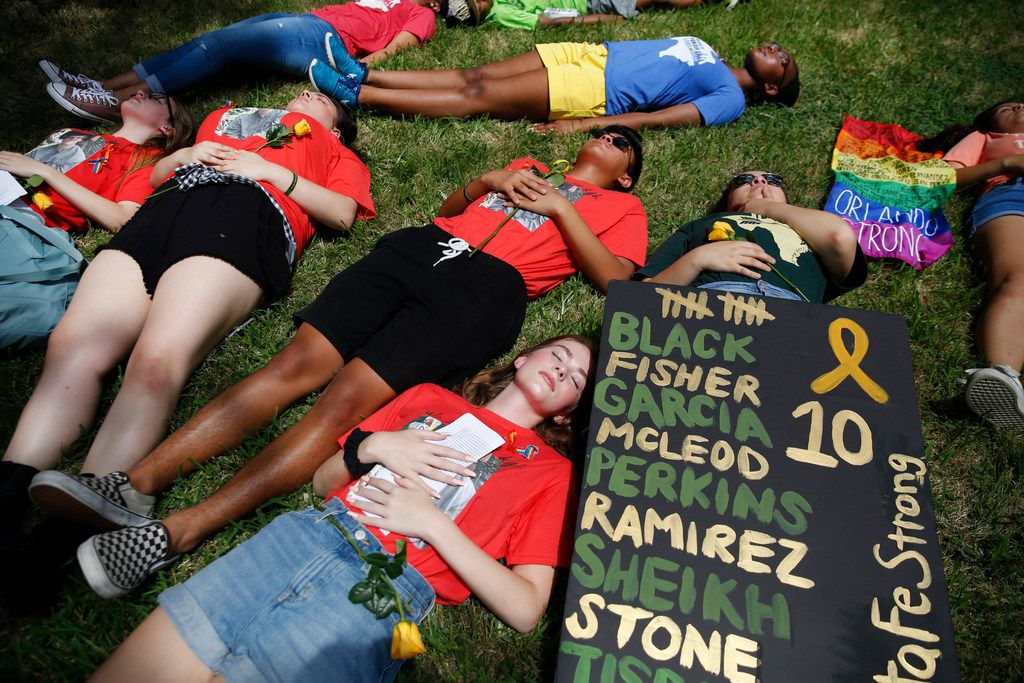 Danika McLeod (bottom), 17, sister of Kyle McLeod, who was killed in the Santa Fe High School shooting, and other students participate in a National Die-In event outside Sen. Ted Cruz's Dallas office on Tuesday, June 12, 2018. The National Die-In was created by students nationwide calling for stricter gun control following mass shootings. (Rose Baca/The Dallas Morning News)