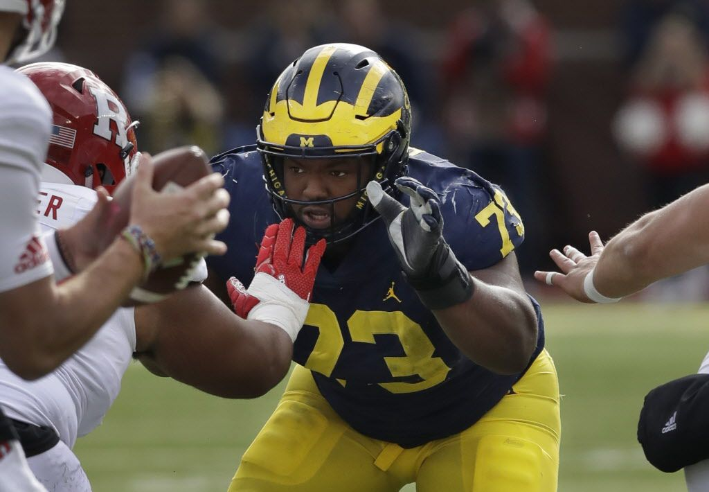 FILE - In this Oct. 28, 2017, file photo, Michigan defensive lineman Maurice Hurst (73) goes up against the Rutgers line during the first half of an NCAA college football game in Ann Arbor, Mich.  (AP Photo/Carlos Osorio, File)