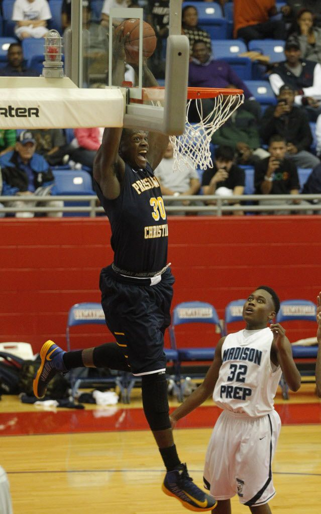 Prestonwood's Julius Randle (30) prepares to dunk in front of  Madison Prep Academy's Delvin Spann (32)  during the Thanksgiving Hoopfest  at Sandra Meadows Arena in Duncanville on November 23, 2012.  (Michael Ainsworth/The Dallas Morning News)