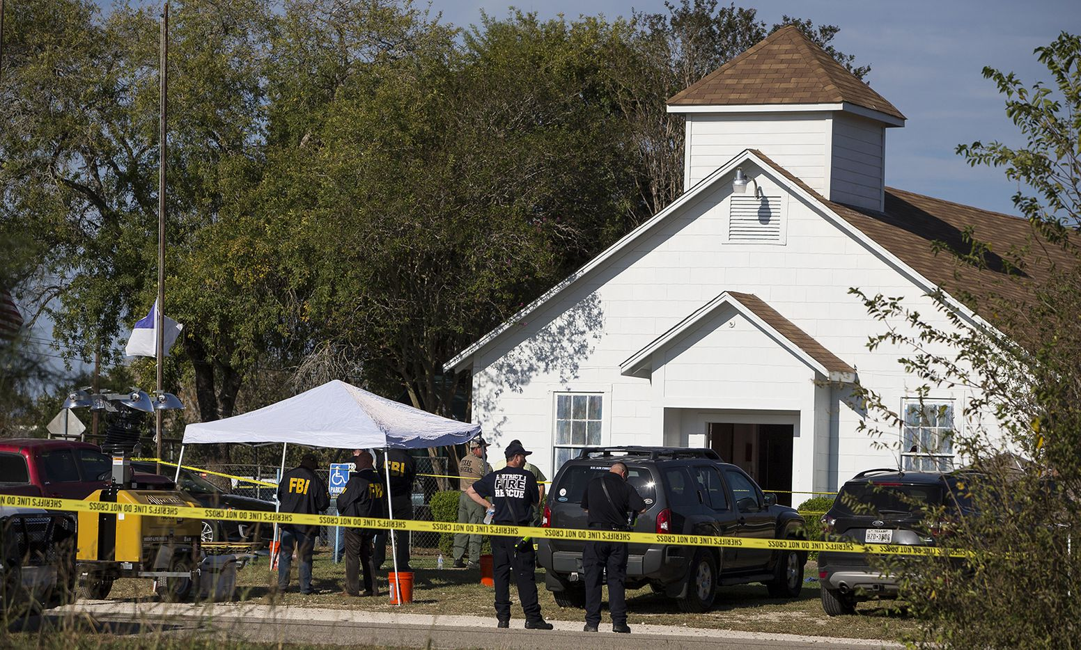 Law enforcement officials works at the scene of a fatal shooting at the First Baptist Church in Sutherland Springs, Texas, on Sunday, Nov. 5, 2017.