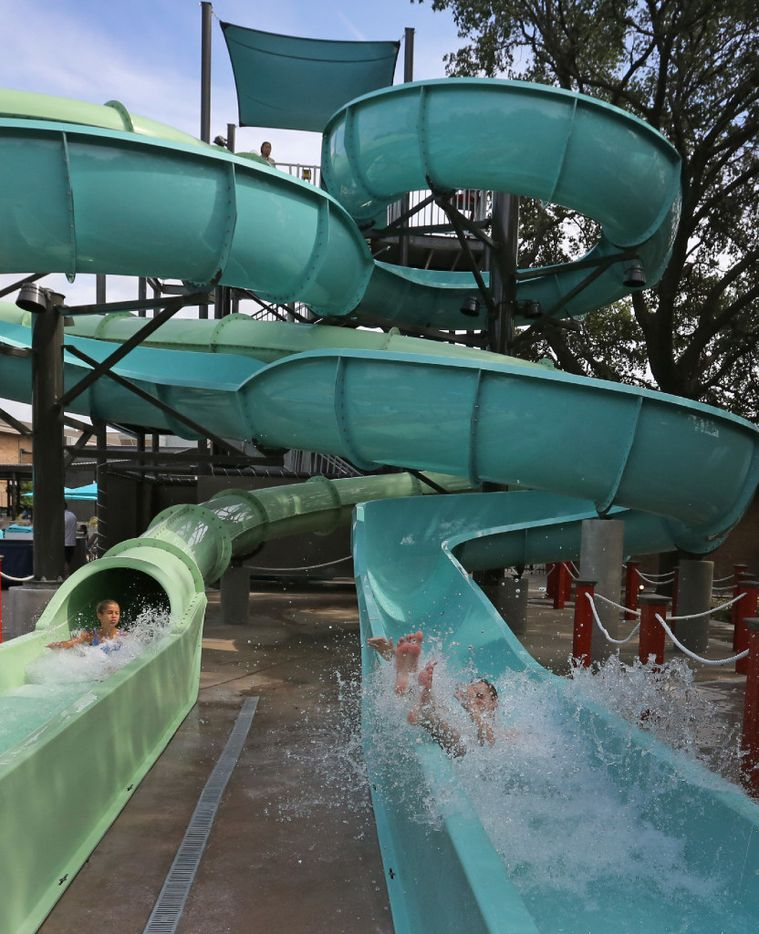 Two 30-foot water slides entertain swimmers of all ages at JadeWaters, the water park and lazy river at the Hilton Anatole Hotel in Dallas, photographed on Friday, May 26, 2017. (Louis DeLuca/The Dallas Morning News)