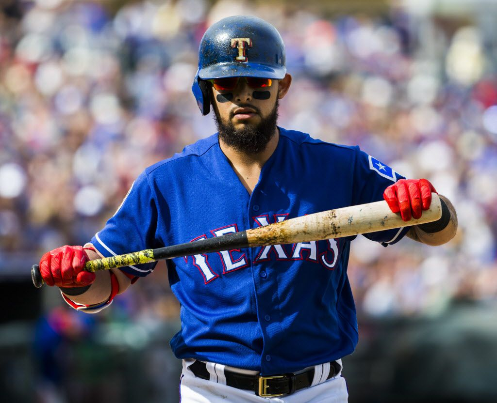 Texas Rangers second baseman Rougned Odor (12) walks back to the dugout after striking out during the fourth inning of a spring training game against the Chicago Cubs at the Rangers' training facility on Sunday, March 5, 2017 in Surprise, Arizona. (Ashley Landis/The Dallas Morning News)