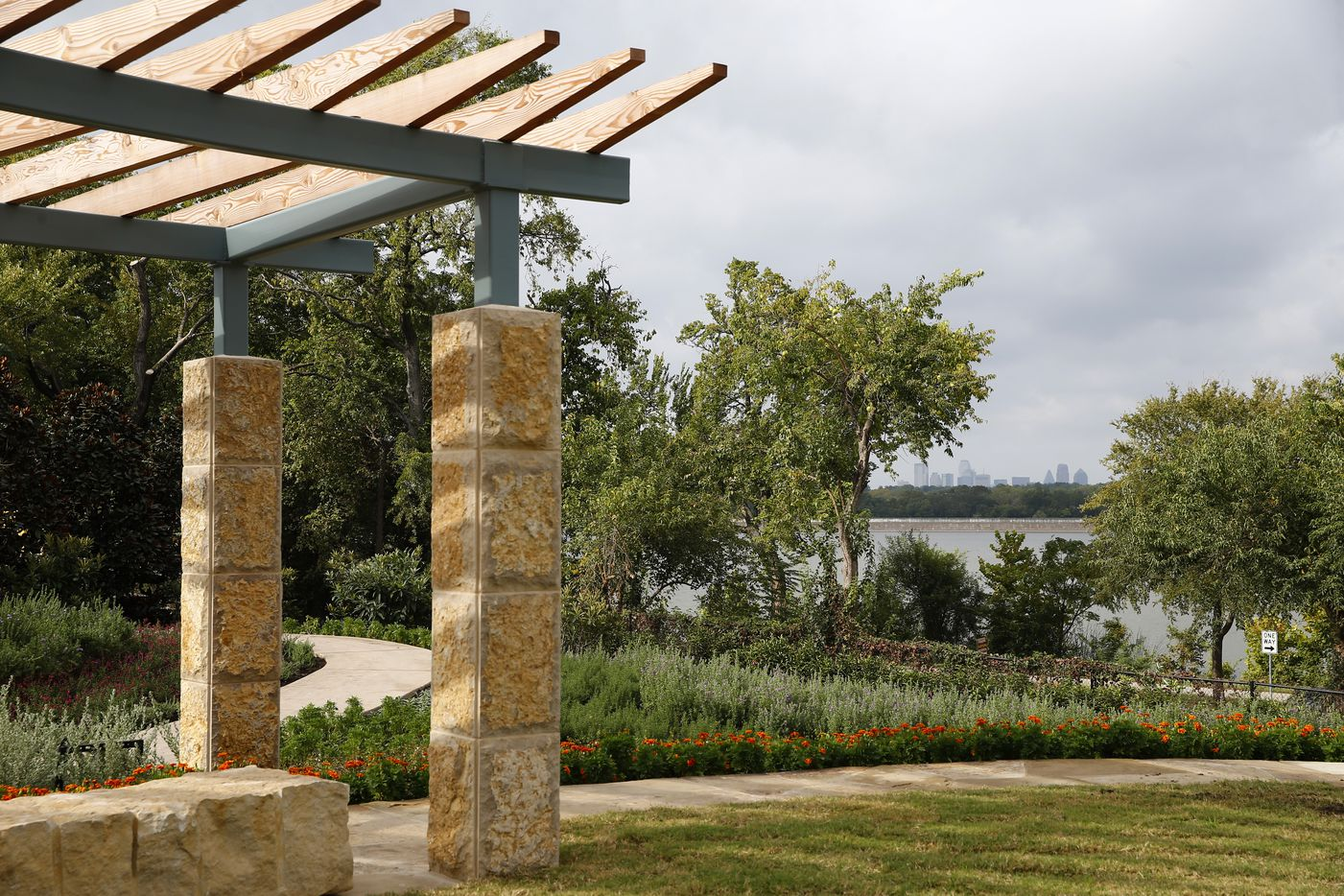 The Dallas skyline is seen in the distance over White Rock Lake from a Tasteful Place vegetable garden at the Dallas Arboretum.