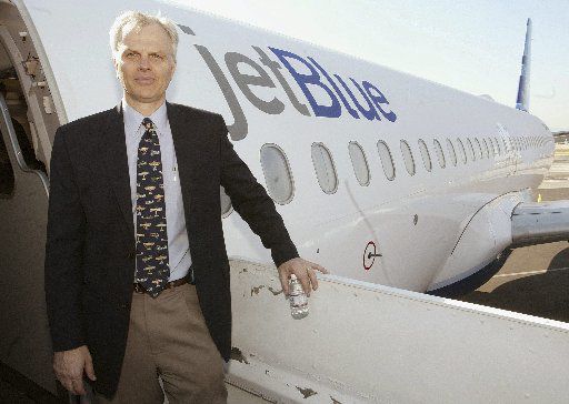 FILE photo shows David Neeleman standing beside a JetBlue A320 airliner at the Burbank airport in Burbank, California in 2005. EPA/BRENDAN MCDERMID