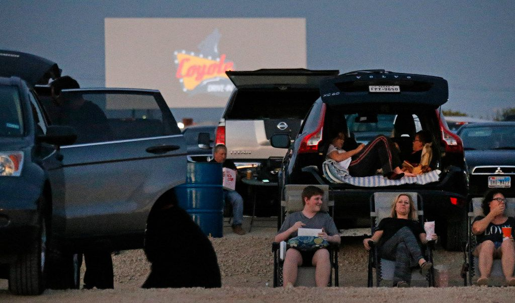 Families wait for the sun to go down at the Coyote Drive-In in Lewisville, Texas, photographed on Saturday, October 29, 2016. (Louis DeLuca/The Dallas Morning News)