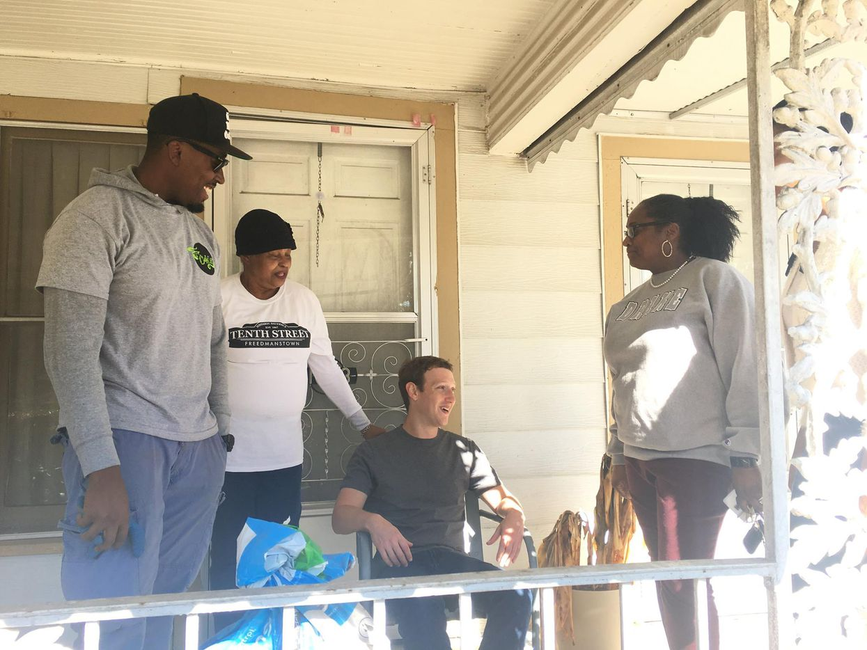 Mark Zuckerberg sits on Taylor Toynes's grandmother's porch in Oak Cliff.