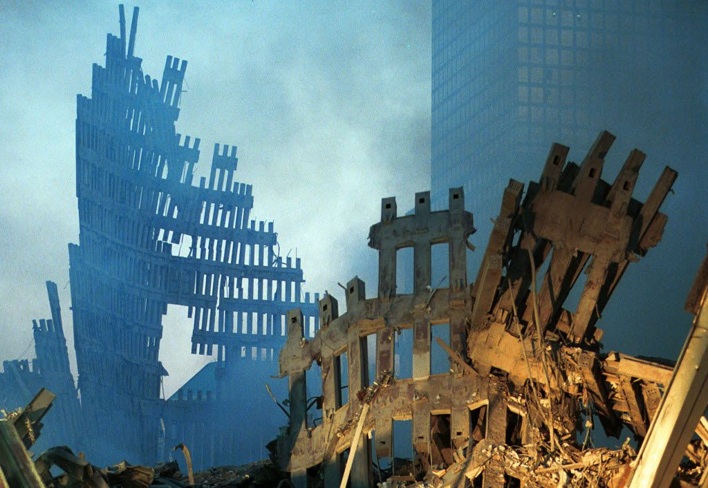Early-morning light hit the smoke and wreckage of the World Trade Center on Sept. 13, 2001, two days after the Twin Towers in New York City were destroyed.