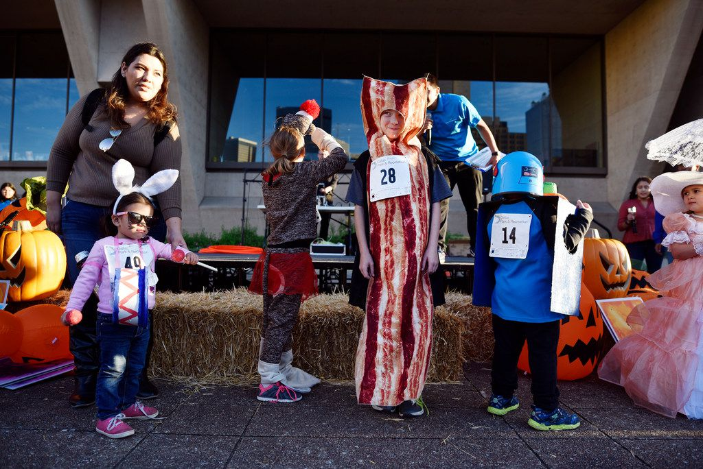 Modeling costumes at Pumpkins on the Plaza at Dallas City Hall. Photo by Ben Torres for Dallas Morning News.