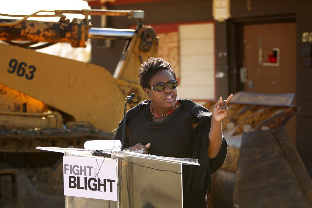 Dallas city councilwoman Carolyn Davis delivers an emotional speech to those in attendance for Dallas Area Habitat for Humanity's bulldozing of a blighted property, Thursday, January 19, 2012 as part of its Fight the Blight Initiative. Davis pleaded guilty to two federal bribery counts in February.