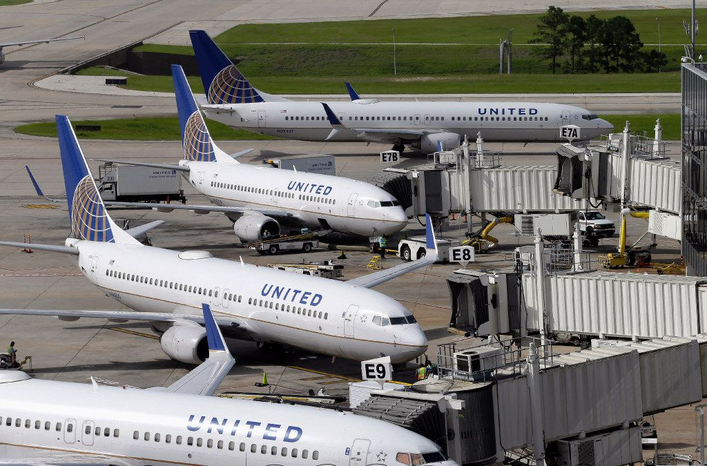 FILE - In this July 8, 2015, file photo, United Airlines planes are parked at their gates as another plane, top, taxis past them at George Bush Intercontinental Airport in Houston. United Airlines says it will raise the limit to $10,000 on payments to customers who give up seats on oversold flights and will increase training for employees as it deals with fallout from the video of a passenger being violently dragged from his seat. (AP Photo/David J. Phillip, File)