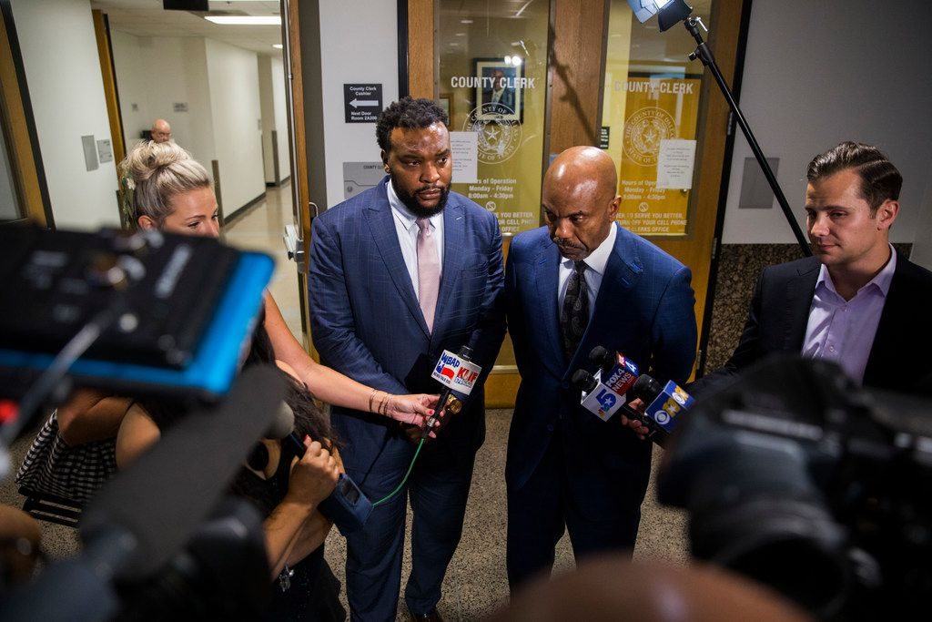 Attorneys Lee Merritt (left) and Daryl Washington spoke to reporters in the hallway outside the Central Jury Room as potential jurors were polled for Amber Guyger's murder trial.