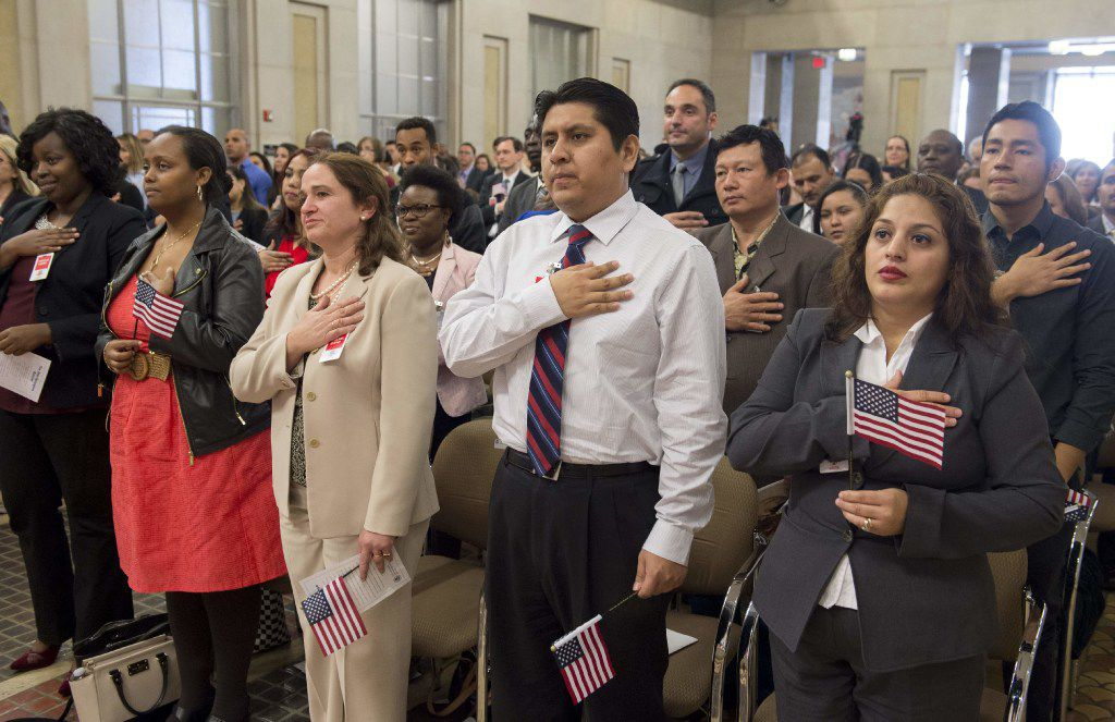 Candidates for U.S. citizenship take the oath of allegiance this week in a ceremony in Washington, D.C. (Saul Loeb/Getty Images)