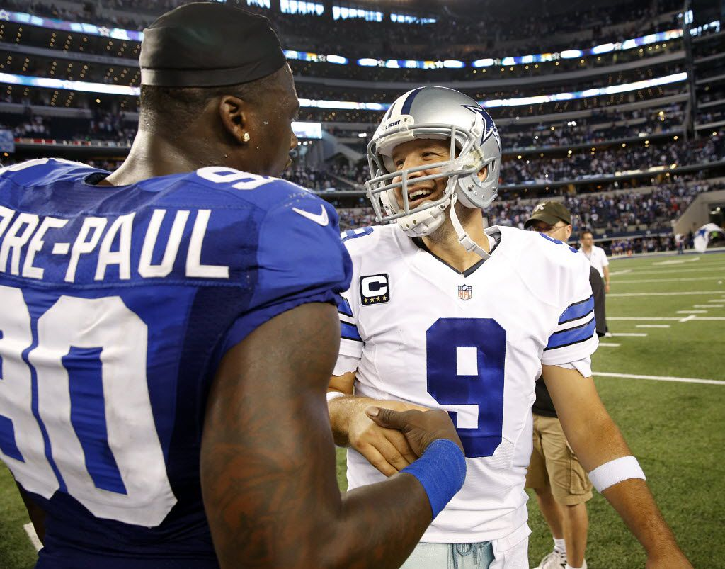 Dallas Cowboys quarterback Tony Romo (9) and New York Giants defensive end Jason Pierre-Paul (90) meet at midfield after the game to chat following the Cowboys win at AT&T Stadium in Arlington, Texas, Sunday, October 19, 2014. The Cowboys won, 31-21.(Tom Fox/The Dallas Morning News)