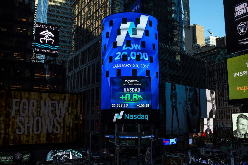 The display at Nasdaq Tower in New York's Times Square shows that the Dow Jones industrial average closed above the 20,000-point mark for the first time, Wednesday, Jan. 25, 2017.