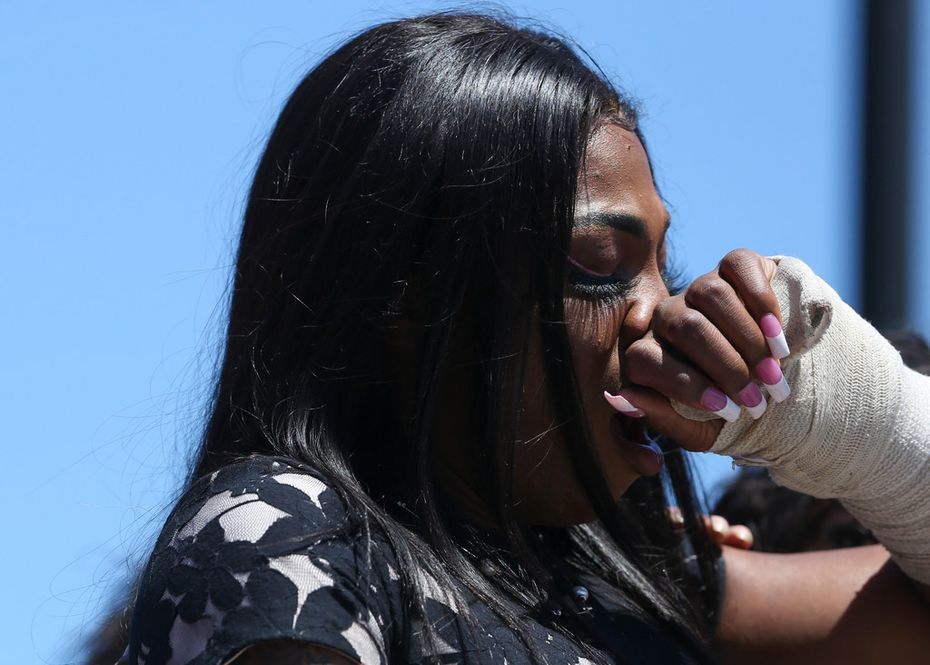 Muhlaysia Booker appeared Saturday at a rally in Dallas, the first time she's spoken publicly since the April 12 attack.