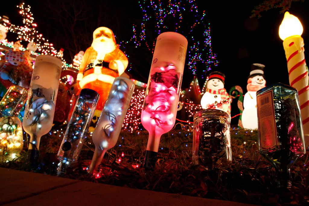 """Bottles filled with lights line the walkway at the home of Liz Simmons, at 714 Newell Ave in Dallas on Dec. 16, 2018. The extravagant Christmas display, called """"Electric Lizzy Land"""" will be on display through the end of the year.(Michael Ainsworth/Special Contributor)"""
