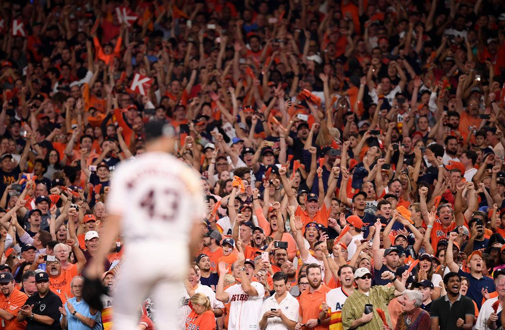 Houston Astros fans cheer as their team closed in on the American League pennant in the ninth inning of Game 7 of the American League Championship Series at Minute Maid Park in Houston on Oct. 21, 2017. The Astros beat New York, 4-0.
