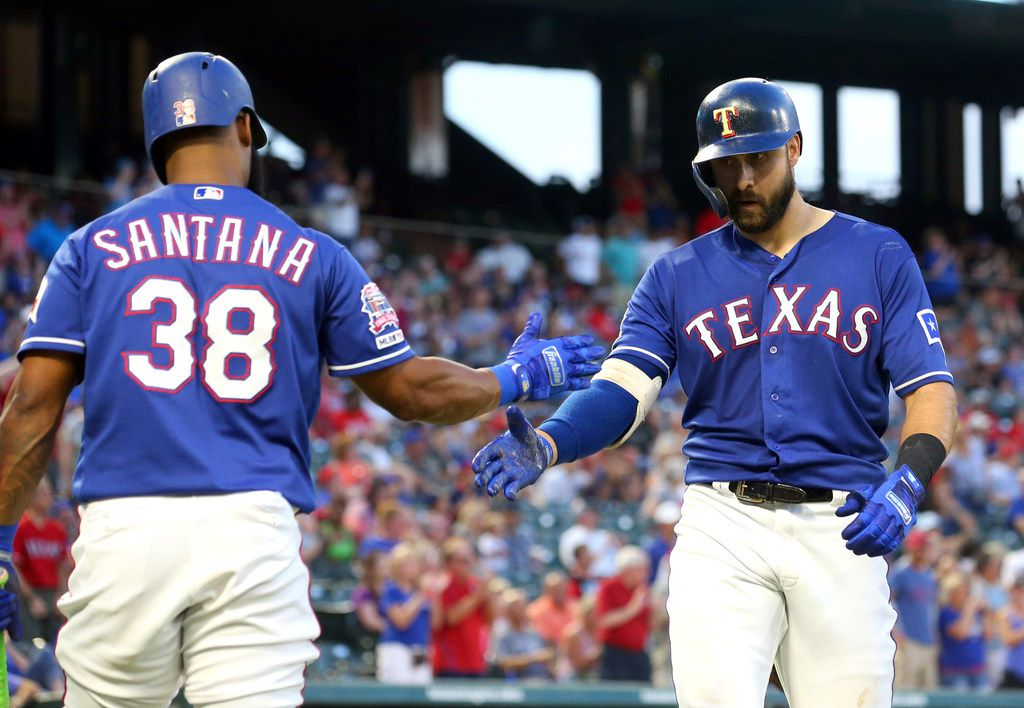 Texas Rangers' Danny Santana (38) celebrates the solo home run by Joey Gallo (13) during the fourth inning of the team's baseball game against the Arizona Diamondbacks Tuesday, July 16, 2019, in Arlington, Texas. (AP Photo/Richard W. Rodriguez)