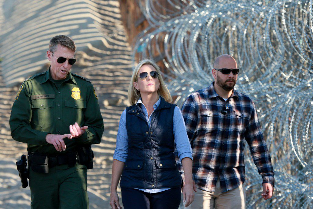 In this Nov. 20, 2018, photo, Kirstjen Nielsen, Secretary of the Department of Homeland Security, tours the border with San Diego Section Border Patrol Chief Rodney Scott at Borderfield State Park in San Ysidro, Calif. On Apri 7, 2019, President Donald Trump that she would leave her position.