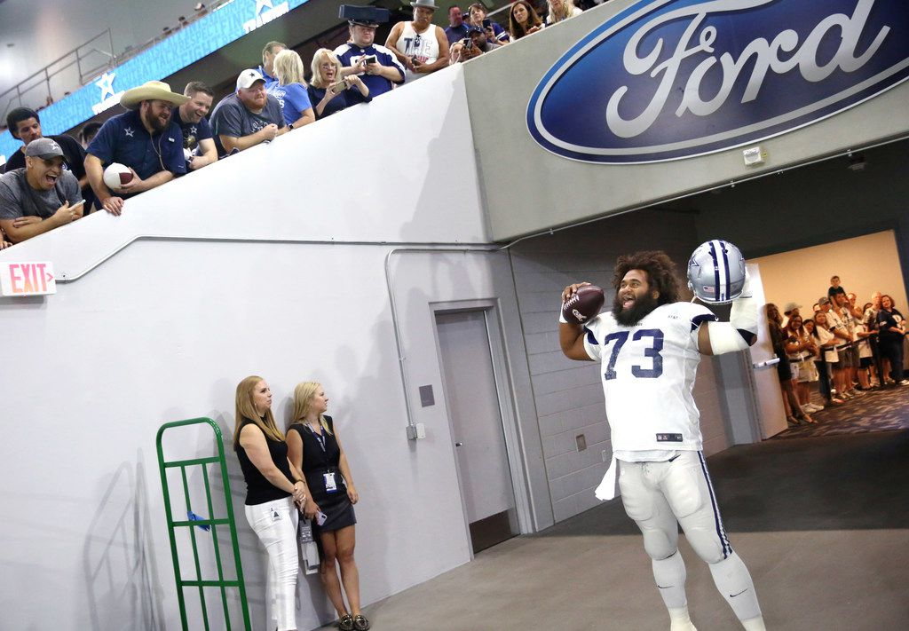 Dallas Cowboys center Joe Looney (73) cheers with fans during the Dallas Cowboys training camp in the Ford Center at The Star in Frisco, Texas on Tuesday, Aug. 20, 2018. (Lynda M. Gonzalez/The Dallas Morning News)