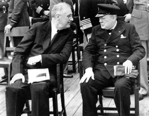 President Franklin D. Roosevelt, left, and British Prime Minister Winston Churchill confer after church services aboard the battleship Prince of Wales during the Atlantic Conference at Argentia Bay off Newfoundland in this  Aug. 10, 1941 file photo.  (AP Photo/FILE)