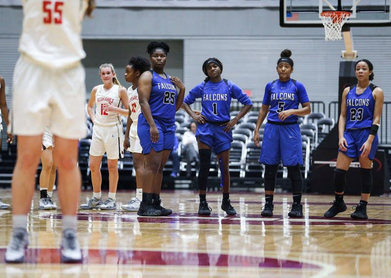 The North Forney Lady Falcons watch as Frisco Liberty's Kelsey Kurak (55) shoots a free throw during the second half of a girls basketball Class 5A Region II semifinal between Frisco Liberty and North Forney on Friday, Feb. 22, 2019 at the Curtis Culwell Center in Garland, Texas. Frisco Liberty beat North Forney 39-25. (Ryan Michalesko/The Dallas Morning News)