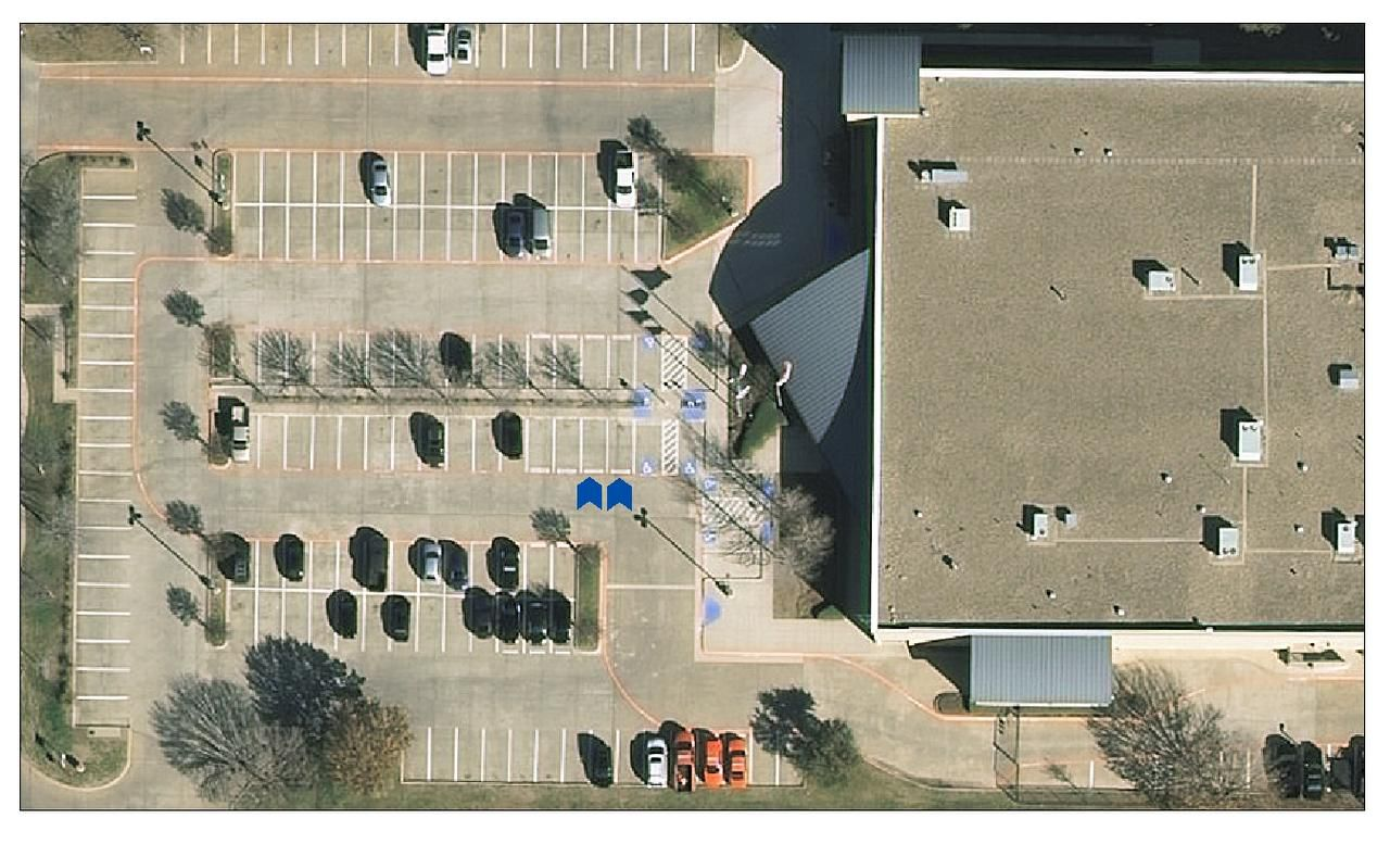 Flower Mound Police Department recently added two designated parking spaces for online transactions. This aerial graphic has two blue arrows pointing to where the spots are in relation to the building.