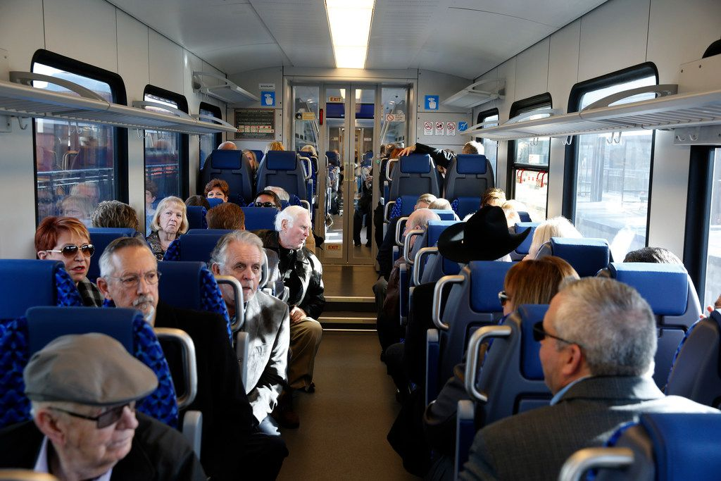 Travelers wait in their chairs for a maiden trip of the Trinity Metro TEXRail to go to DFW Airport from the Grapevine/Main Street Station in Grapevine, Texas on Dec 31, 2018.  (Nathan Hunsinger/The Dallas Morning News)