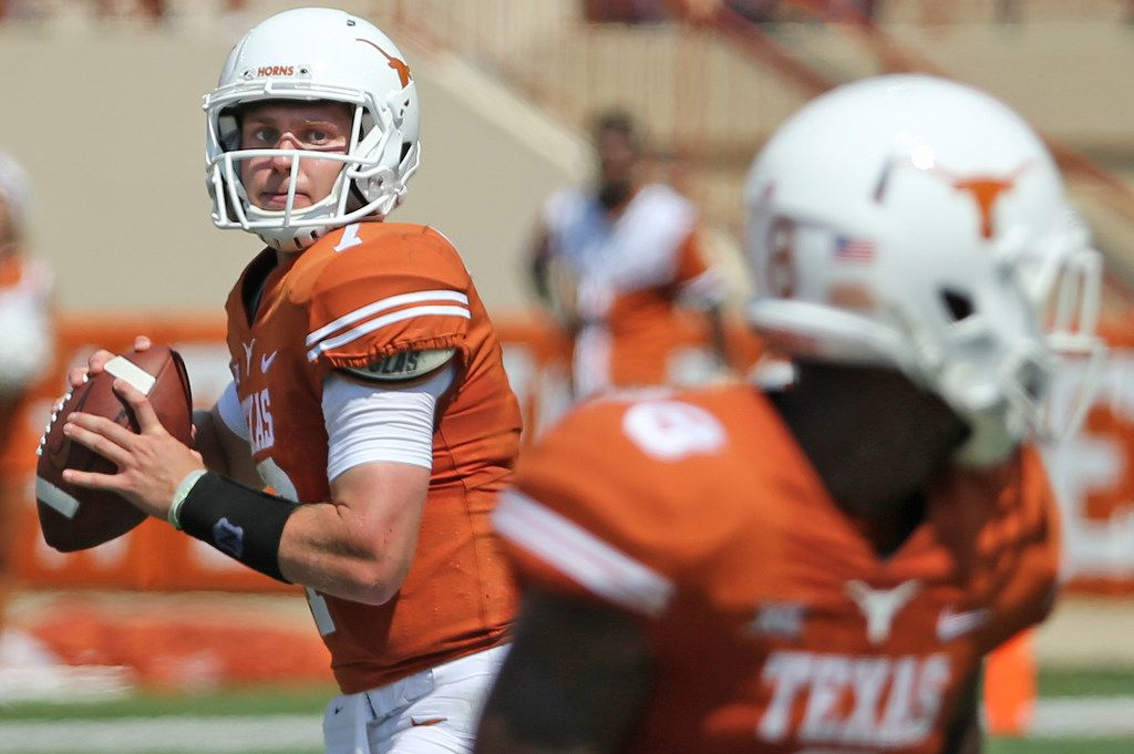 Texas Longhorns quarterback Shane Buechele (7) looks for a receiver during the University of Maryland Terrapins vs. the University of Texas Longhorns NCAA football game at Darrell K Royal Texas Memorial Stadium in Austin, Texas on Saturday, September 2, 2017. (Louis DeLuca/The Dallas Morning News)