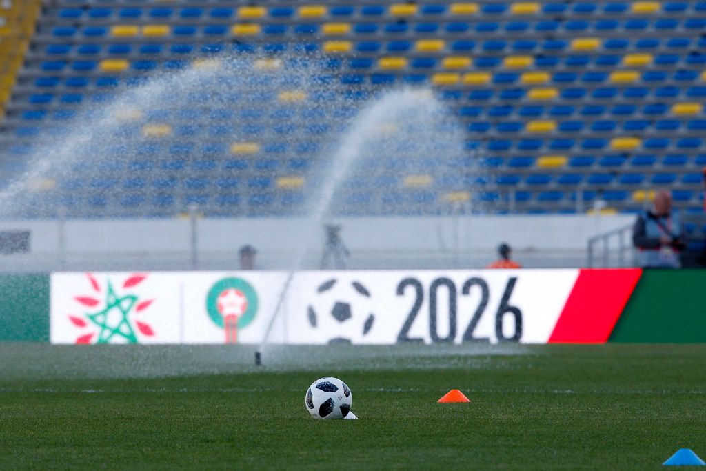 Morocco's bid logo for the organization of World Cup 2026 was posted on billboards before a soccer match between Morocco and Uzbekistan.