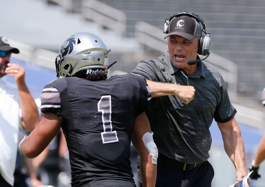 Denton Guyer coach John Walsh celebrates with Kaedric Cobbs (1) after Cobbs scored the winning touchdown against Cedar Hill during the second half of their high school football game in Dallas, Texas on September 7, 2019. (Michael Ainsworth/Special Contributor)