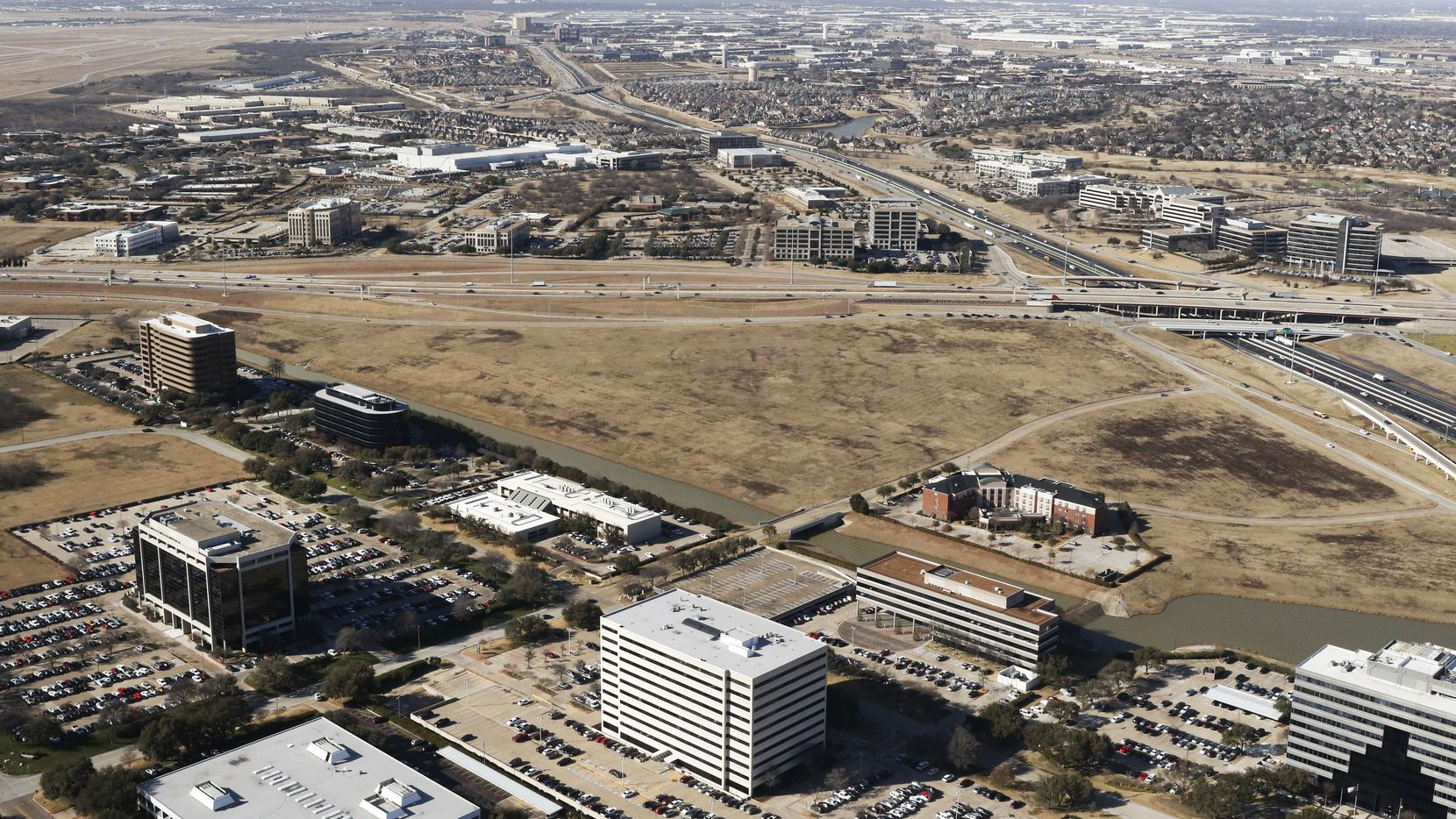Jerry Jones' Blue Star Land and Lincoln Property plan to build a project with a hotel, retail and apartments at the vacant south corner of State Highways 114 and 161 in Las Colinas.