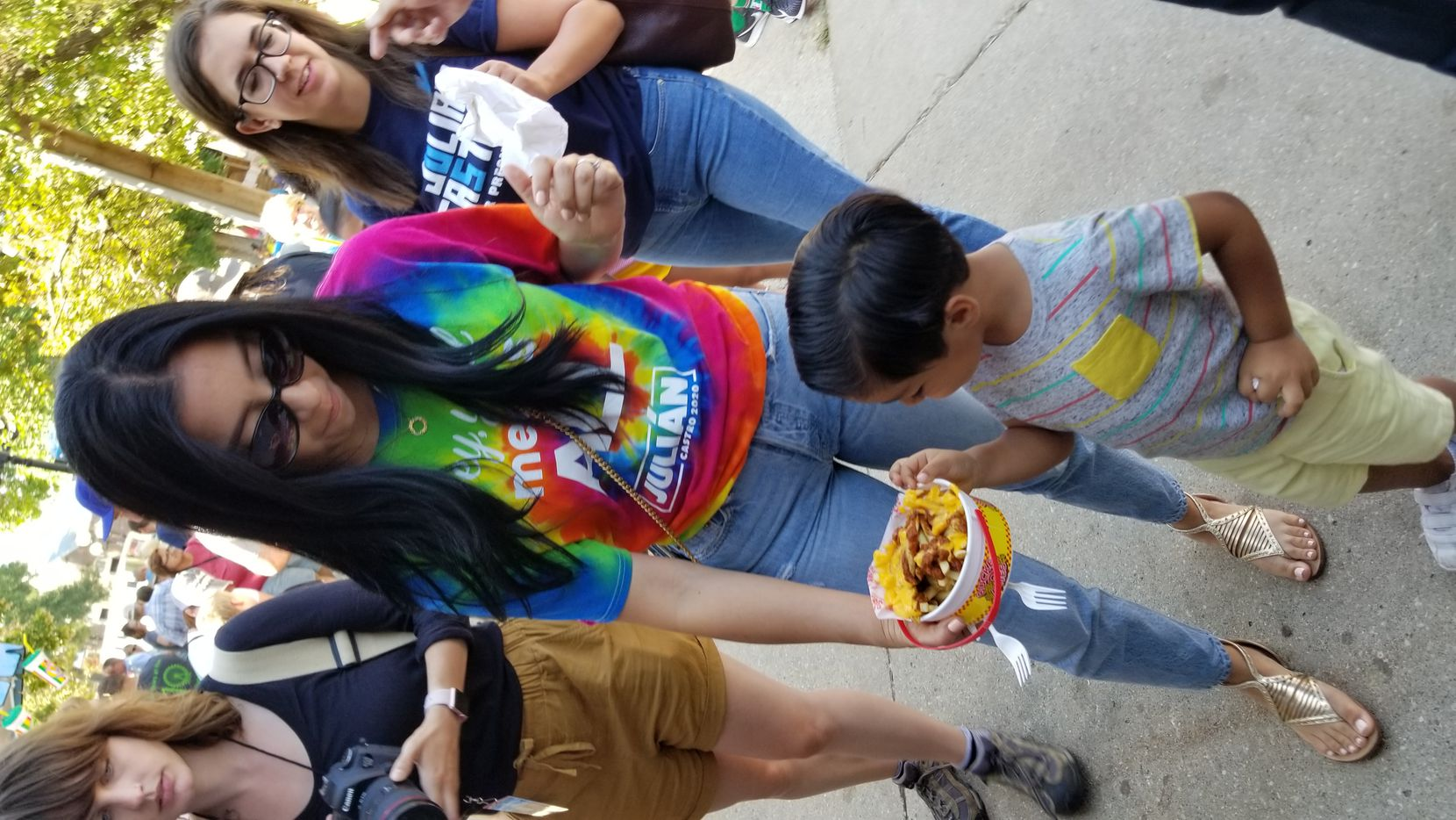 Erica Castro offers chili cheese fries to her son Cristián, 4, at he Iowa State Fair on Aug. 9, 2019, as husband Julián Castro stumps nearby for president.