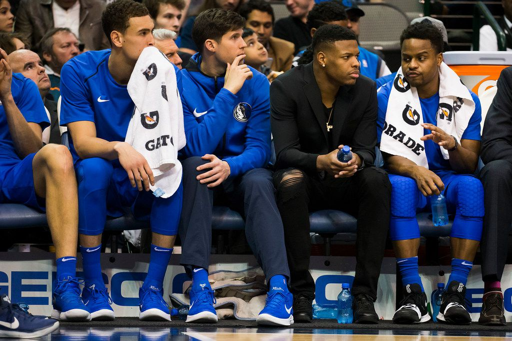 FILE - Mavericks guard Dennis Smith Jr. watches from the bench as he talks with Yogi Ferrell during the first half of a game against the Phoenix Suns at American Airlines Center on Tuesday, April 10, 2018. (Smiley N. Pool/The Dallas Morning News)