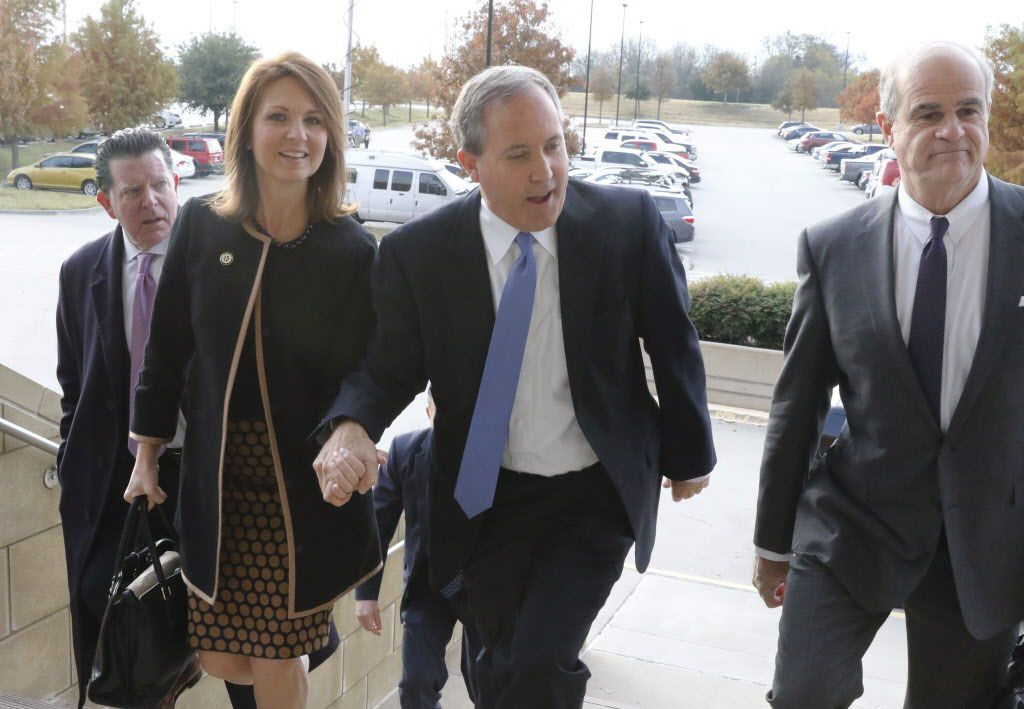 Texas Attorney General Ken Paxton and his wife Angela arrive at the Collin County Courthouse in McKinney, with his attorneys, to hear pre-trial motions on charges of securities fraud on Tuesday, December 1, 2015. (David Woo/The Dallas Morning News)