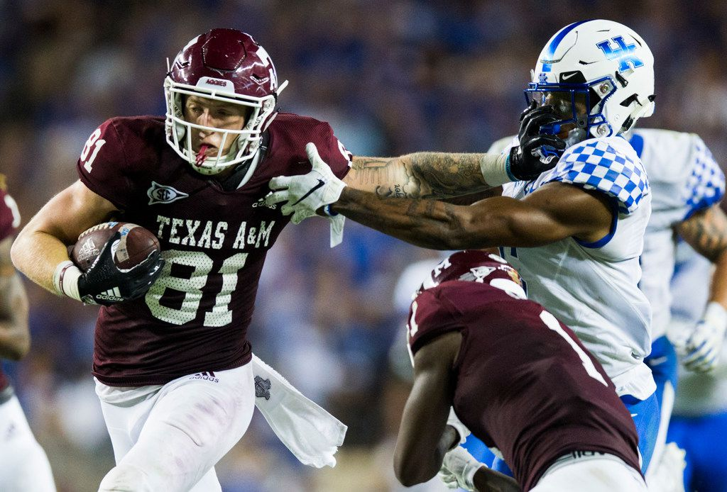 Texas A&M Aggies tight end Jace Sternberger (81) stiff arms Kentucky Wildcats cornerback Lonnie Johnson Jr. (6) as he runs to the end zone for a touchdown during the fourth quarter of an NCAA football game between Kentucky and Texas A&M on Saturday, October 6, 2018 in College Station, Texas. (Ashley Landis/The Dallas Morning News)