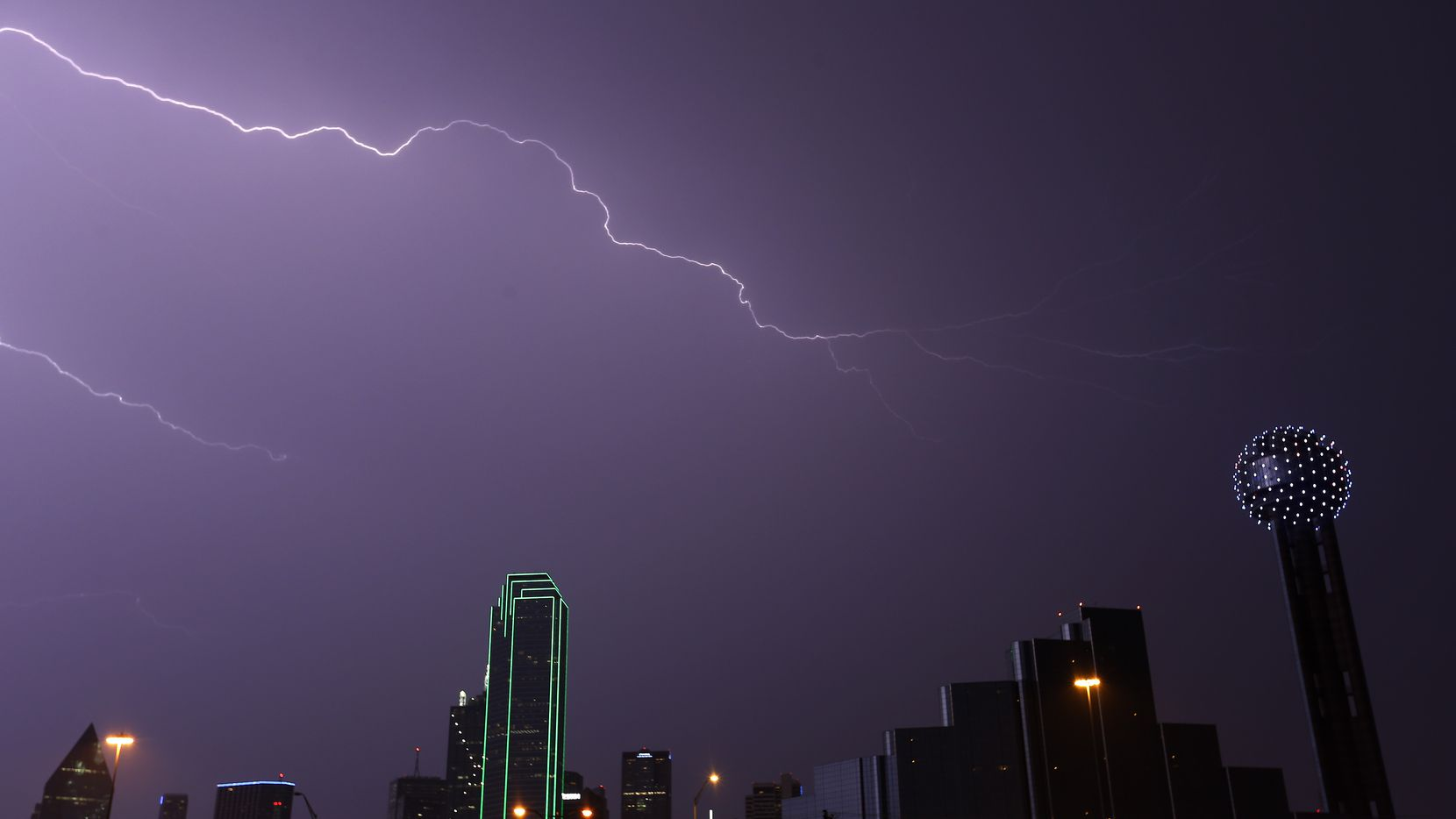 A bolt of lightning strikes over the downtown skyline in Dallas, Tuesday, April 26, 2016. (Jae S. Lee/The Dallas Morning News)