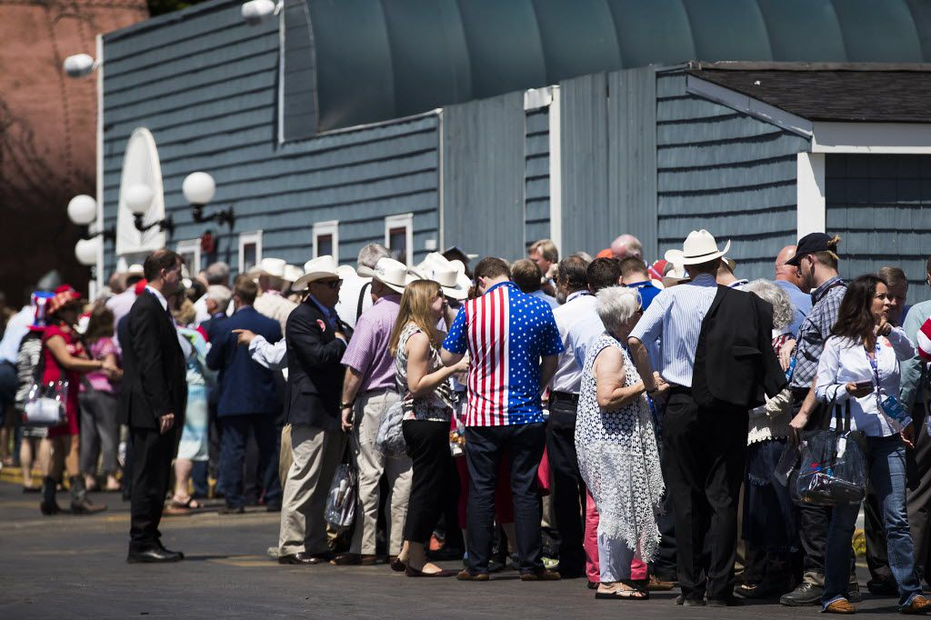 """Supporters wait in line for the doors to open for a Ted Cruz """"thank you"""" event on the third day of the Republican National Convention on Wednesday, July 20, 2016, in Cleveland. (Smiley N. Pool/The Dallas Morning News)"""