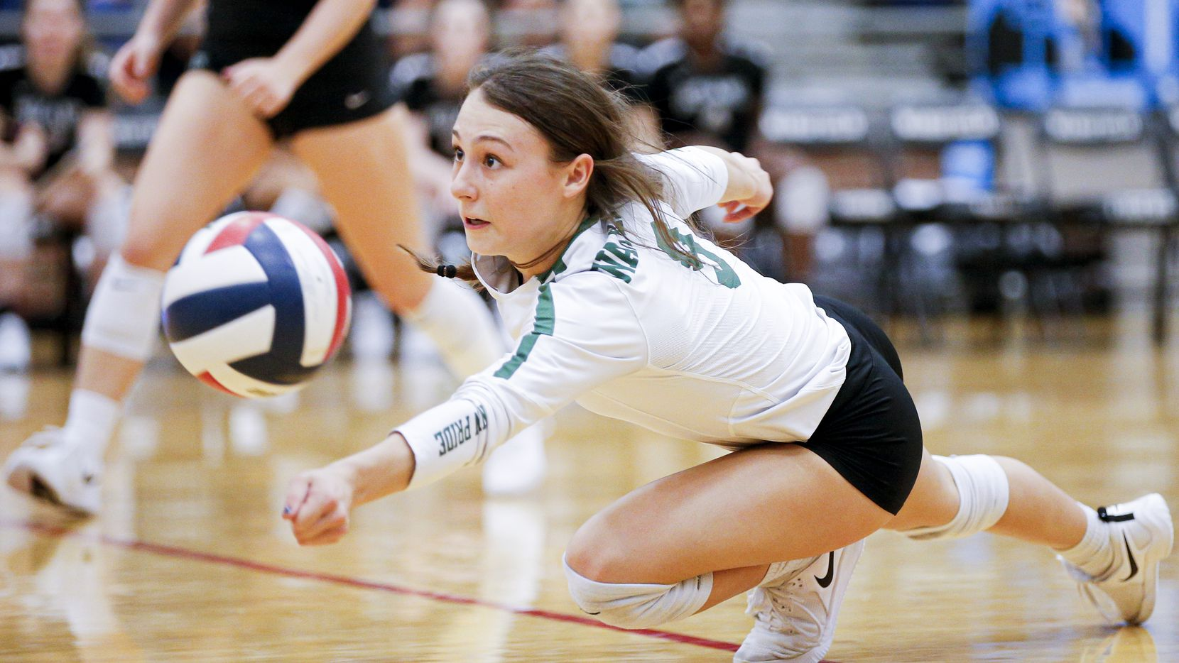Waxahachie senior Baylee Whitehead (9)  dives for the ball during a match against Mansfield on September 24, 2019. (Brandon Wade/Special Contributor)