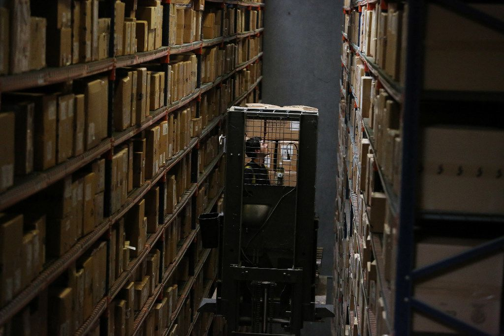 A worker uses a lift while organizing boxes inside The Apparel Group Ltd. distribution center in Lewisville, Texas Thursday August 10, 2017. According to The Apparel Group Ltd., one sixth of the men's button down shirts distributed in the United States are processed through this building. (Andy Jacobsohn/The Dallas Morning News)