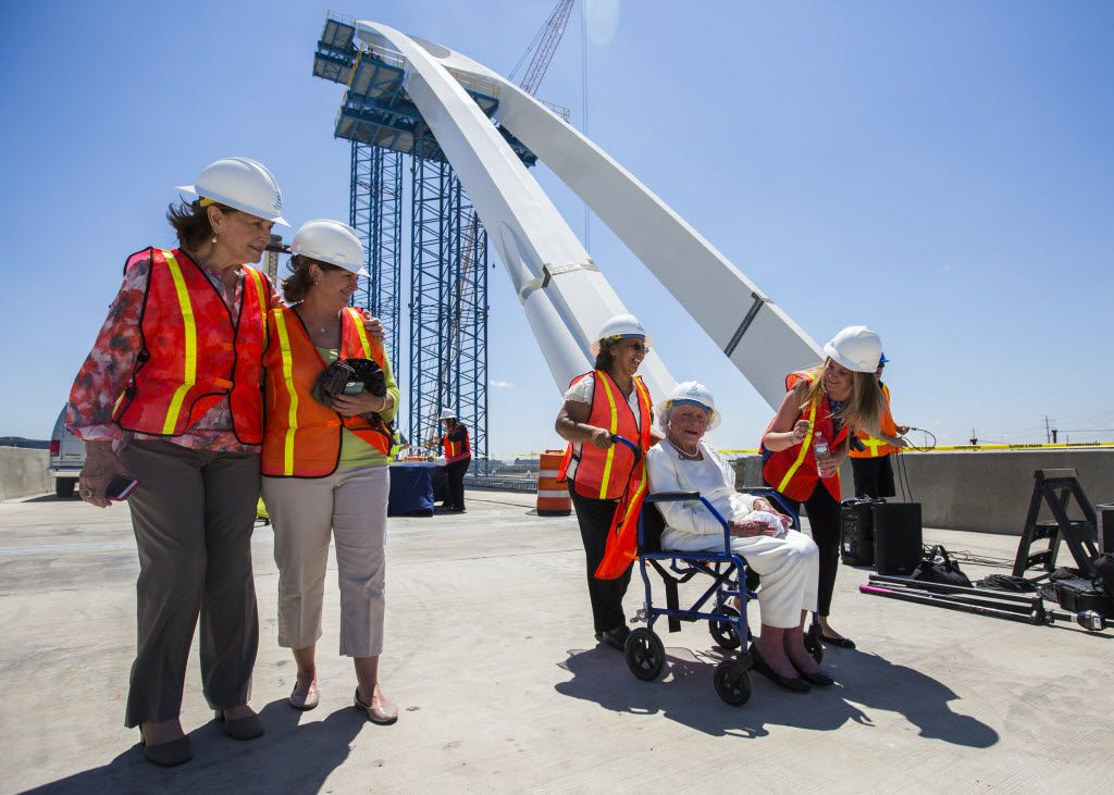 Margaret McDermott, second from right, is escorted on the Margaret McDermott Bridge, which is named after her, by Gail Thomas, left, president of The Trinity Trust; Mary McDermott Cook, daughter of McDermott; Susana Mutzus, McDermott's attendant, and Grace Cook, McDermott's grand daughter after a bridge signing ceremony on June 11, 2015 in Dallas.