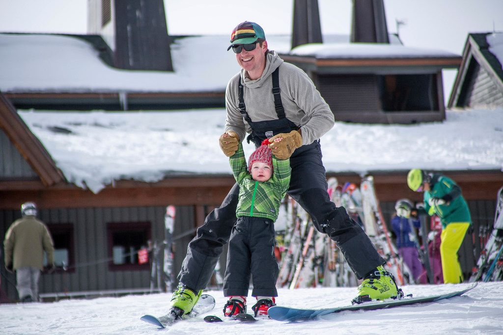 Phillip Supino skis with his son Charles, 2, for his first day in his life on skis on Aspen Mountain in Colorado for opening day Nov. 17, 2018.
