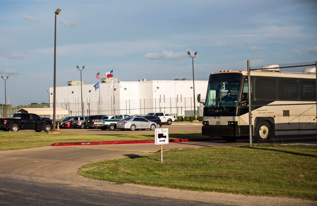 A empty bus leaves the T Don Hutto Residential Center in Taylor, Texas on June 25, 2018. (Thao Nguyen/Special Contributor)