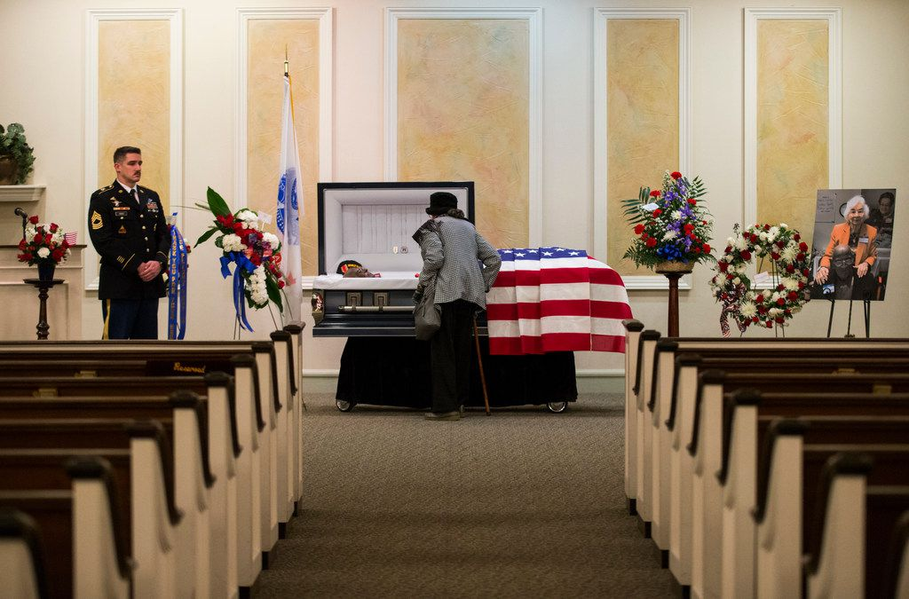 A woman who identifies as Miss K views the remains of Richard Overton lay at Cook-Walden Funeral Home in Austin on Friday, Jan. 11, 2019,  the day before his funeral service and burial. Overton was the oldest living veteran and oldest living male at 112 years old until he died on Dec. 27, 2018. He was known for drinking whiskey and smoking cigars on his front porch in East Austin.