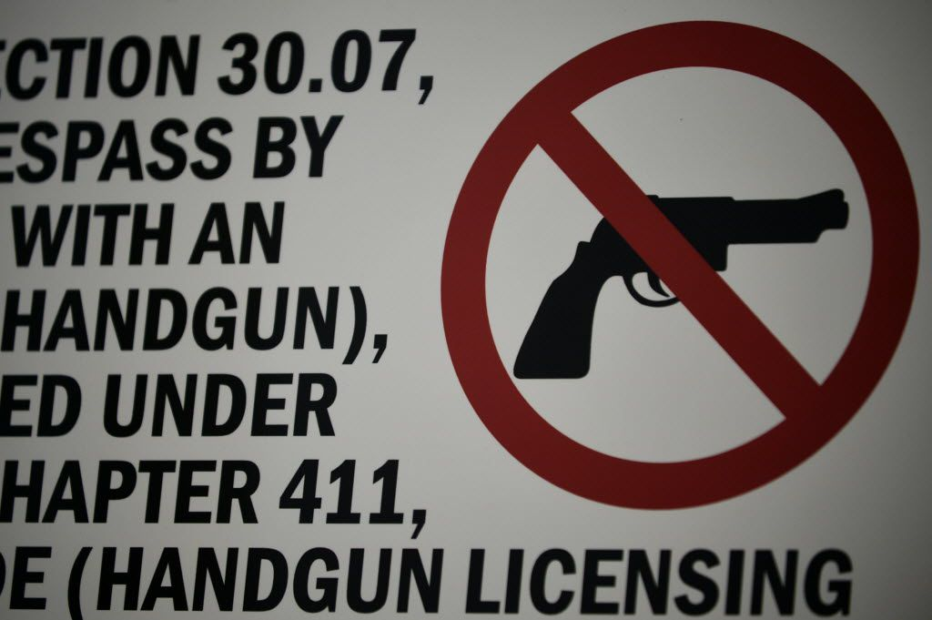 A sign that prohibits the open carry of handguns at Threesixty Theater on Friday, December 18, 2015 in Dallas. (Rachel Woolf/The Dallas Morning News)