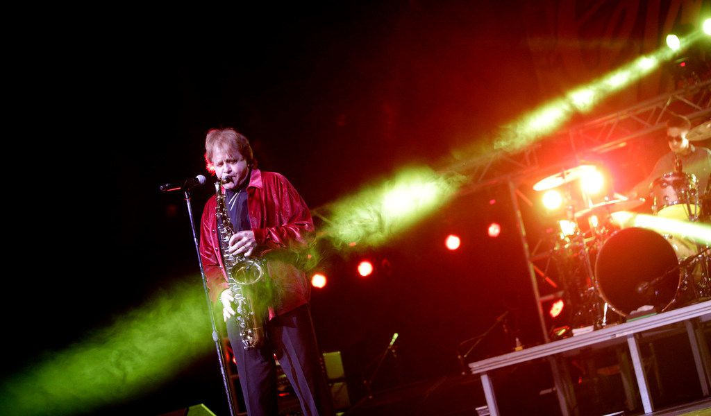 In this April 2, 2016 file photo, Eddie Money performs at GlenOak High School in Canton, Ohio.   Family members have said Eddie Money has died on Friday, Sept. 13, 2019. (Bob Rossiter/The Repository via AP)