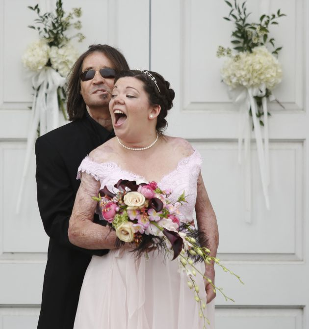 Dallas Wiens and Jamie Nash pose for pictures after getting married at Ridglea Baptist Church in Fort Worth on March 30, 2013.