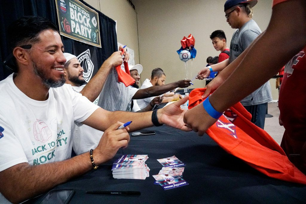 Texas Rangers pitcher Yovani Gallardo signs autographs for kids at the Back to School Block Party at Refuge Church in Fort Worth, Texas on Saturday August 18, 2018. (Lawrence Jenkins/Special Contributor)