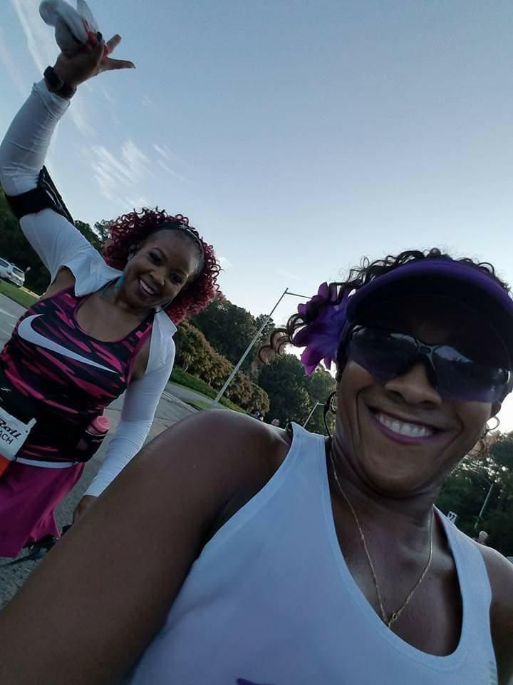 Daphyne Jackson (left) and one of her running friends, Scymentress Williams, celebrate another half marathon in the books.