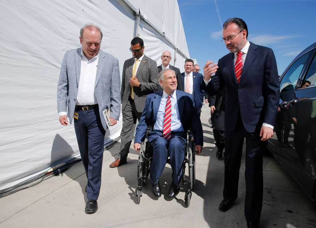 Luis Miguel Monroy Carillo (from left) talks with Govenor Greg Abbott  along with Secretary of Foreign Affairs Luis Videgaray caso during a tour at the grand opening at La Moderna in Cleburne.